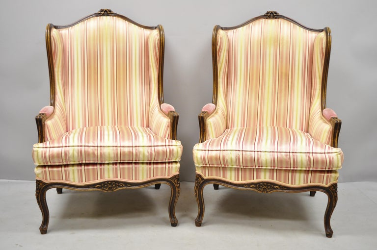 Pair of vintage French Louis XV style wingback bergere armchairs, W & J Sloane. These chairs were made in Italy, and originally sold by W & J Sloane Inc. Items feature solid wood frame, beautiful wood grain, distressed finish, nicely carved details,