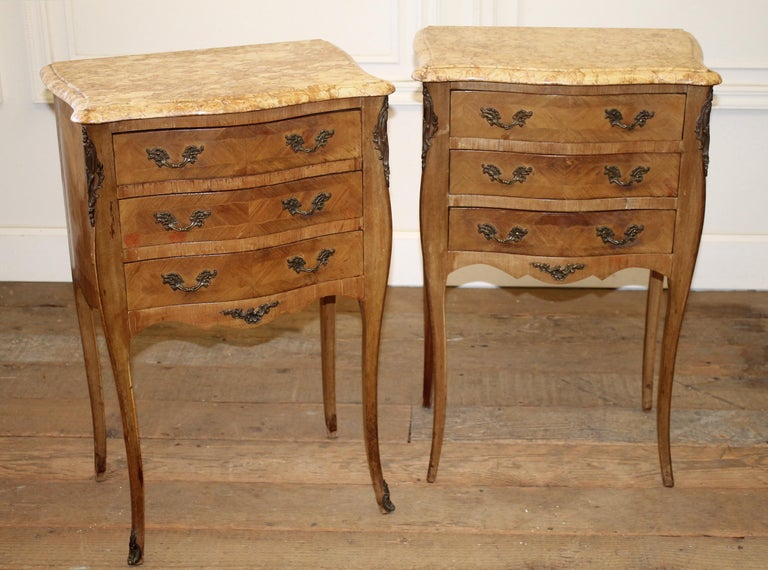 Pair of vintage French style wood nightstands with marble tops