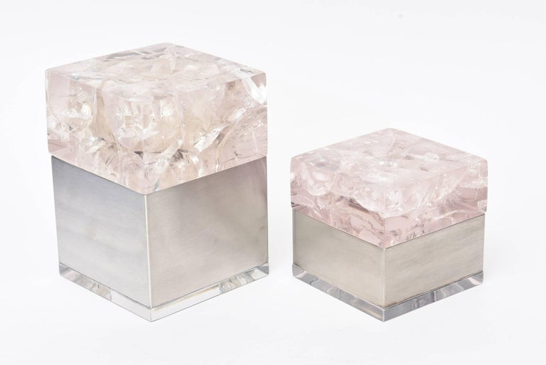 These amazing sculptural french vintage Pierre Giraudon pair of boxes are composed of an encasing of fractured embedded lucite as the tops that sit on brushed stainless steel bottoms with a small lucite base. They are more on the rare side.  The two