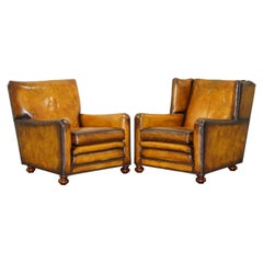 Pair of Vintage Fully Restored Aged Brown Leather Armchairs Solid Walnut Feet
