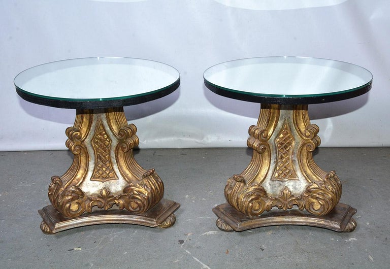 Each of the pair of vintage mirrored top Italian pedestal table bases is finished with three gilt double volutes and silver gilt panels. Perfect as end tables or as a pair of side-by-side coffee tables or use the two bases and add a larger top for a