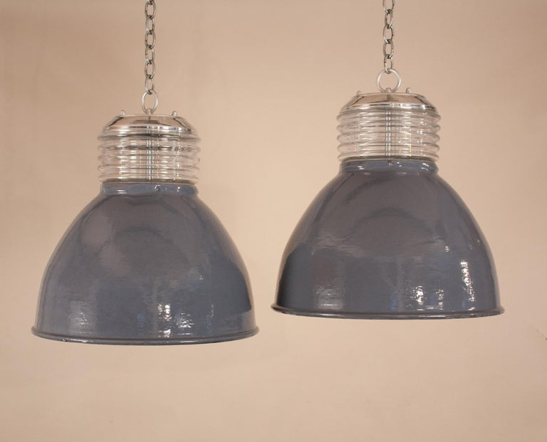Custom-designed from vintage components, these larger-sized Industrial pendants are one-of-a-kind. The gray enamel shades with white interiors are from the 1960s. With their age comes expected minor blemishes (as shown in photos) that add to the