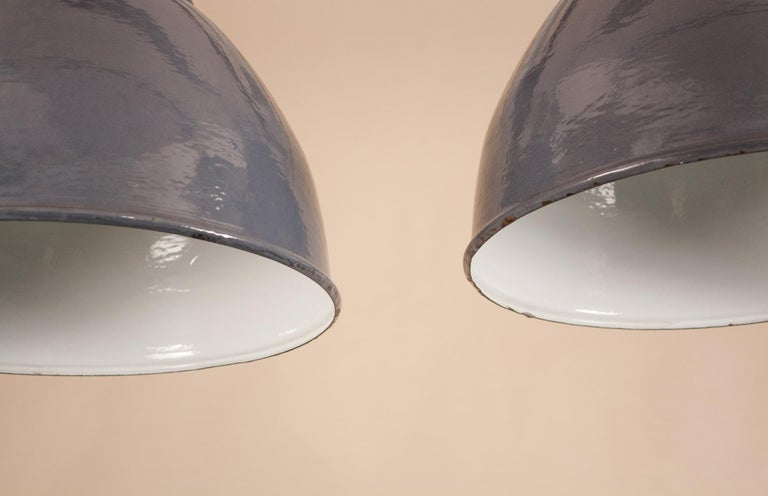 20th Century Pair of Vintage Gray Enamel and Glass Industrial Pendant Lights For Sale