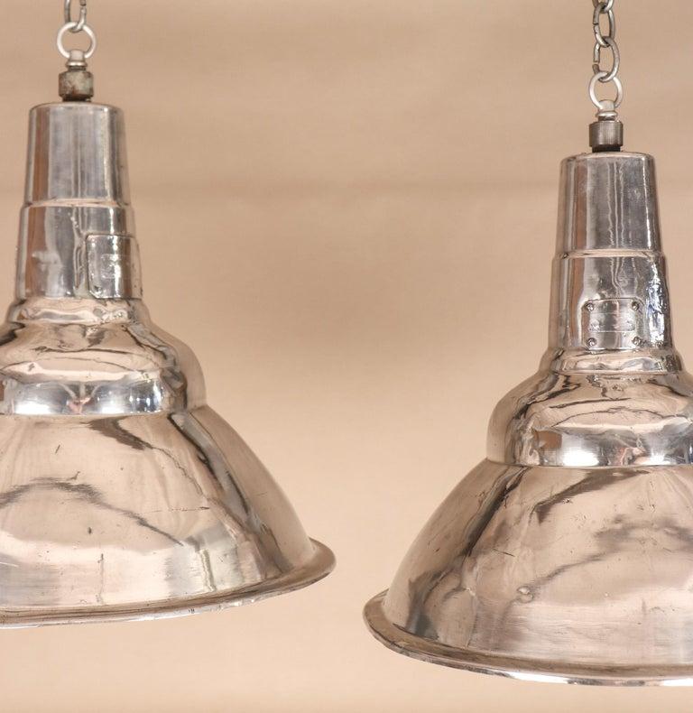 Unknown Pair of Vintage Industrial Aluminum Floodlight Pendants For Sale