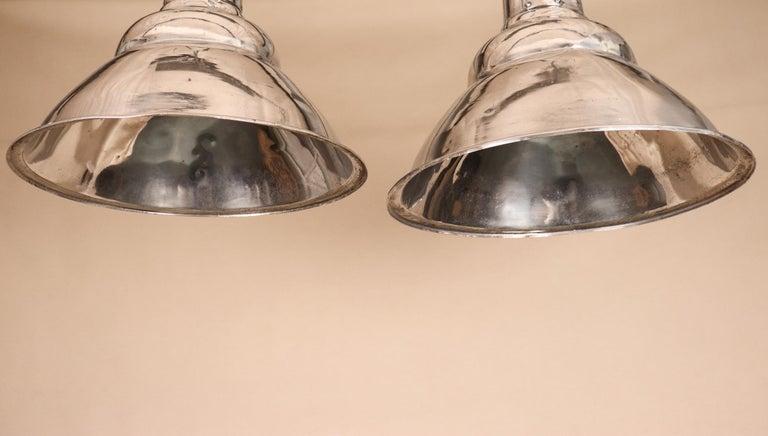 20th Century Pair of Vintage Industrial Aluminum Floodlight Pendants For Sale