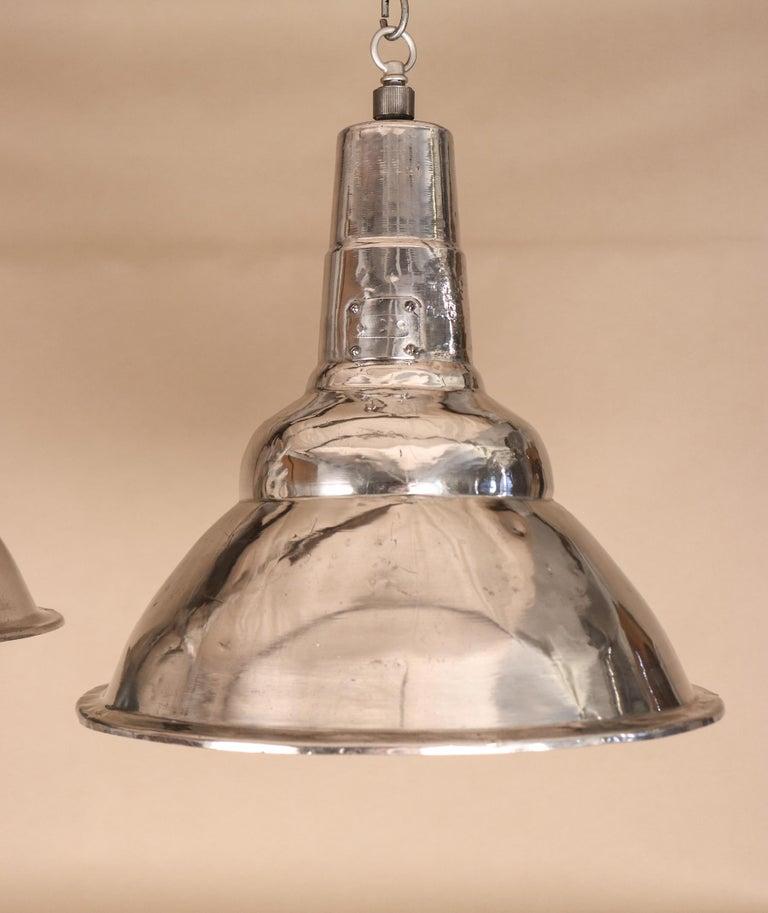 Pair of Vintage Industrial Aluminum Floodlight Pendants For Sale 1