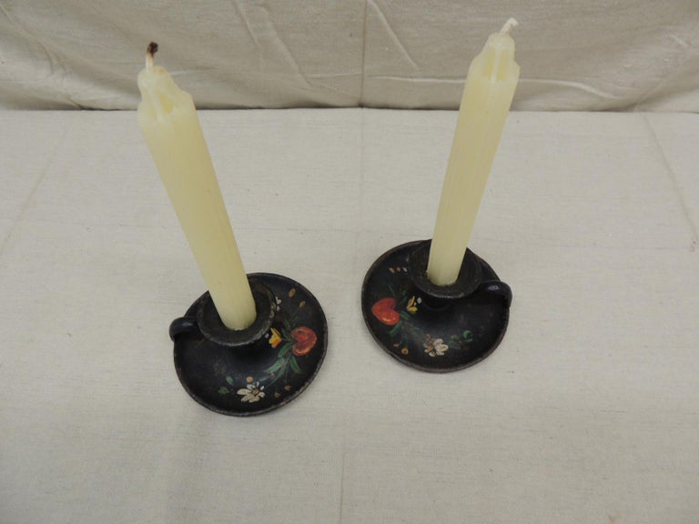 Pair of vintage iron hand painted candleholders. Round Folk Art candleholders painted with hearts and flowers. Size: 4