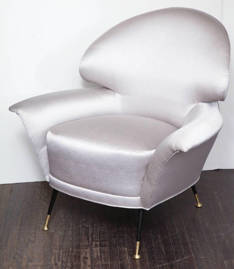 Pair of vintage Italian arrow head chairs upholstered in platinum satin.