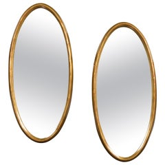 Pair of Vintage Italian Midcentury Tall Giltwood Oval Mirrors with Clean Lines