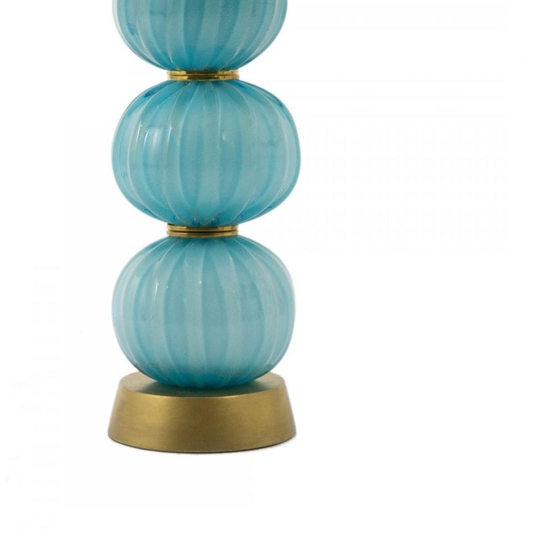 Pair of vintage stacked turquoise textured sphere table lamps, Italy, circa 1960. Opaque glass features gold fleck accents and with gold and brass detail.  Originally purchased from John Salibello.   Includes custom shades as shown.