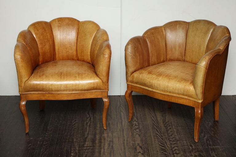 Pair of vintage leather channel back petite chairs.