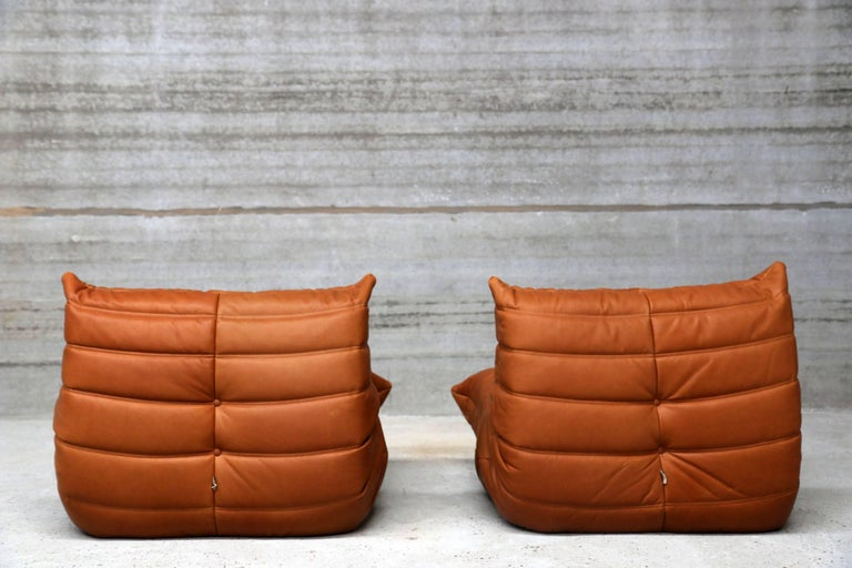 French Pair of Vintage Ligne Roset Togo Leather Lounge Chairs with Pouf, France For Sale