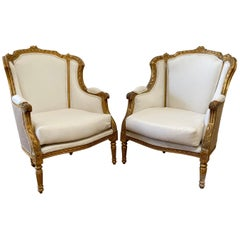 Pair of Vintage Louis XVI Style Wing Back Bergère Chairs