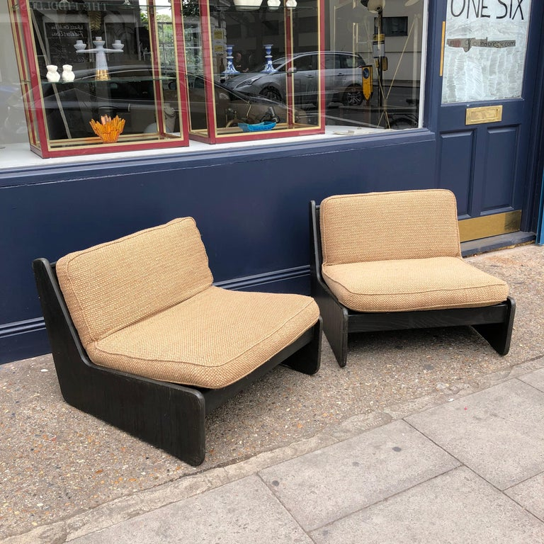 A pair of vintage low seat armchairs. They would benefit new upholstery and webbing. In house upholstery and restoration available. Five armchairs in total.