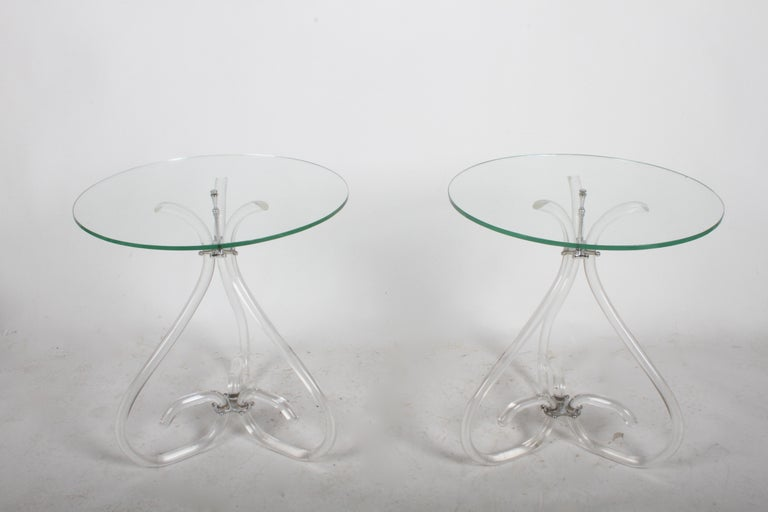 Elegant vintage Lucite and glass side tables in the style of Dorothy Thorpe, circa 1950s. Well constructed, having chrome plated hardware. Lucite is in nice original condition, no breaks or repairs, minor scuffs. Original glass tops have several