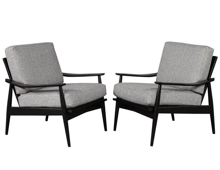 Pair of Vintage Mid-Century Modern Lounge Chairs. Recently restored in a hand rubbed ebony finish and reupholstered in a designer linen fabric.  Price includes complimentary scheduled curb side delivery to the continental USA.