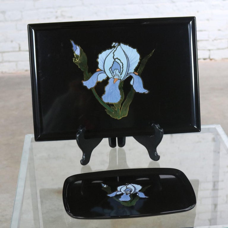 I can almost smell the iris on these trays they look so life-like! This pair of beauties are from Couroc of Monterey. One tray is rectangular, and one is somewhat of an oval. Both with matching inlays of iris. They are made of a special black