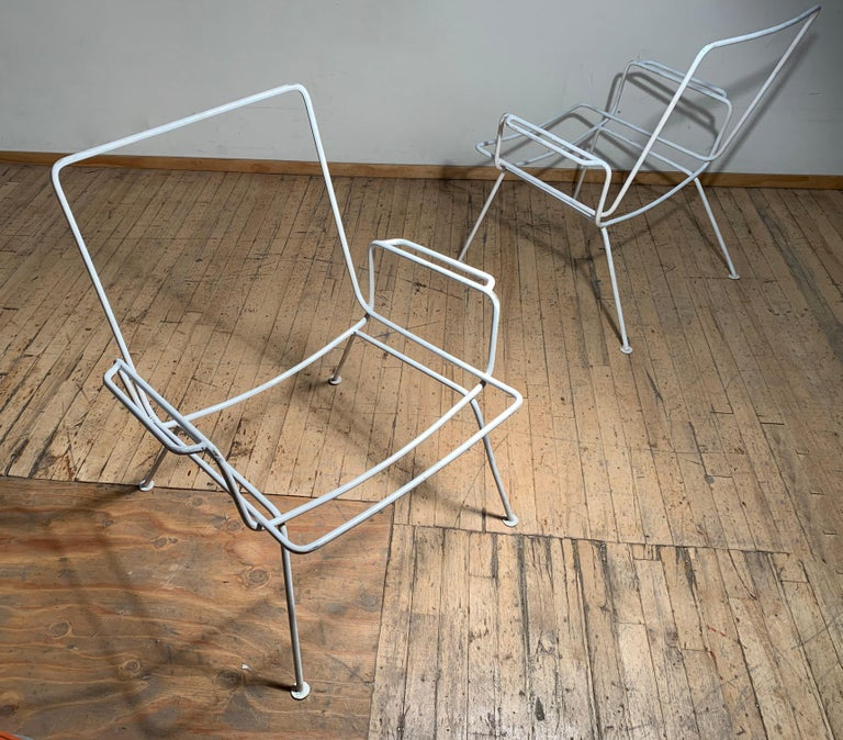 Pair of vintage midcentury wrought iron patio chairs. Most likely European. French or Italian.  Manner of Salterini and milo Baughman  These take a fabric sling seat.