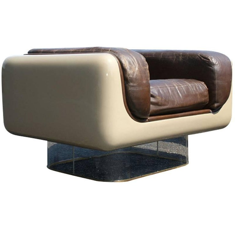 The soft seating line was introducedin May 1972,.  Seats are designed to give firm back support and soft comfort to the body's contours.   Armchairs: Tan fiberglass body  Mounted on clear acrylic bases  Soft original chocolate brown leather