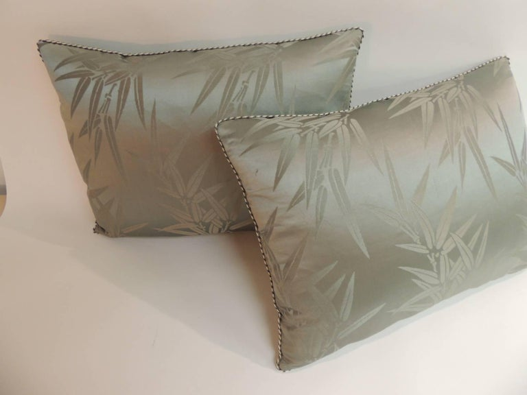 Decorative Moss green vintage silk Obi with woven bamboo leaves' motif in the front panel. Decorative pillows embellished with a small vintage gold and green silk trim. Decorative pillows finished backings with gold strie silk fabrics. Decorative