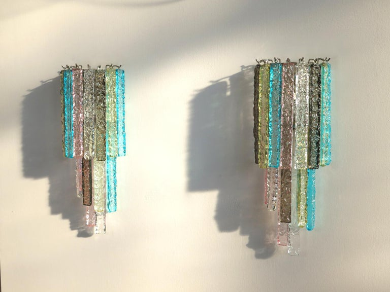 Fantastic pair of vintage Murano wall sconce made by 16 multi-color Murano crystal prism icicle for each applique in a chrome metal frame. The shape of this sconce is spiral. Period: Late 20th century Dimensions: 21.65 inches height (55 cm), 9.85