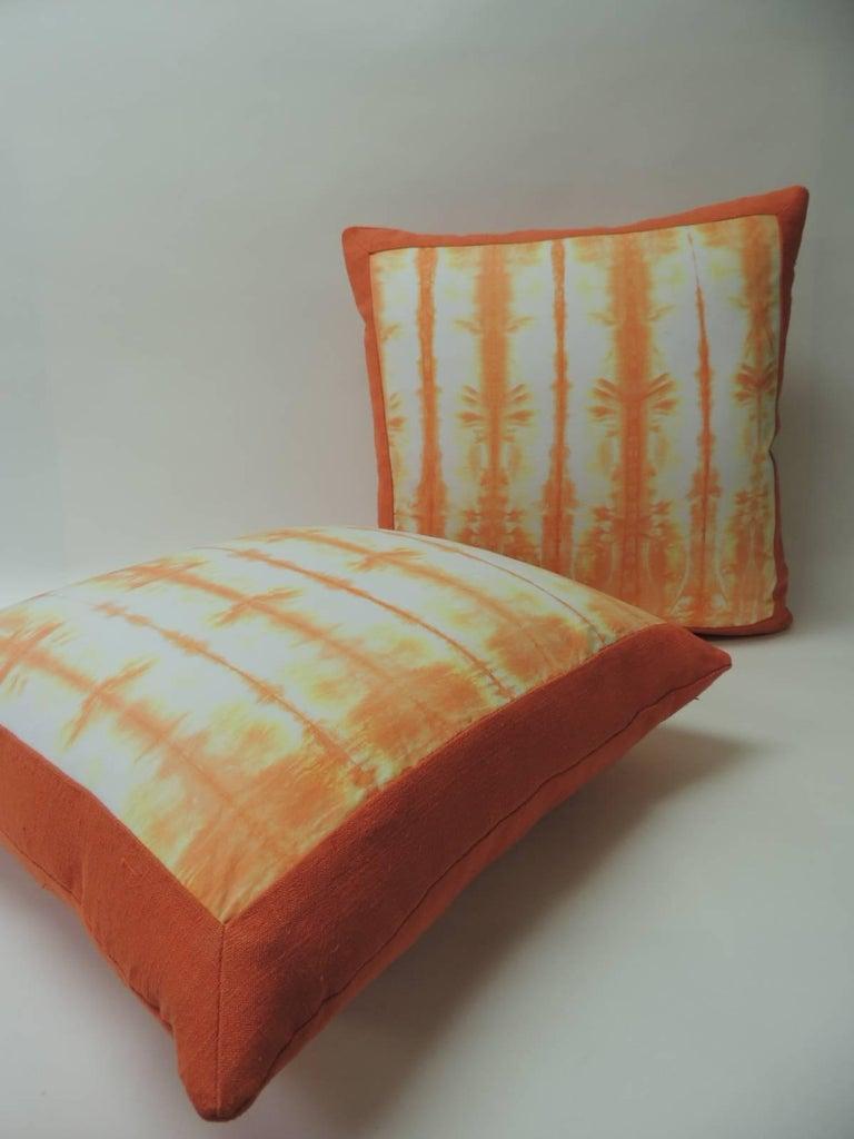 Pair of vintage orange Shibori square throw pillows Asian square decorative pillows handcrafted with a Shibori cotton vintage artisanal textile pattern framed with homespun antique orange linen with the same textile as backing. Throw pillows