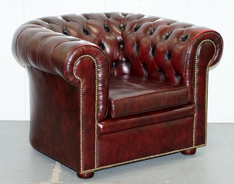 We are delighted to offer this lovely pair of vintage hand made in England Chesterfield Oxblood leather club armchairs