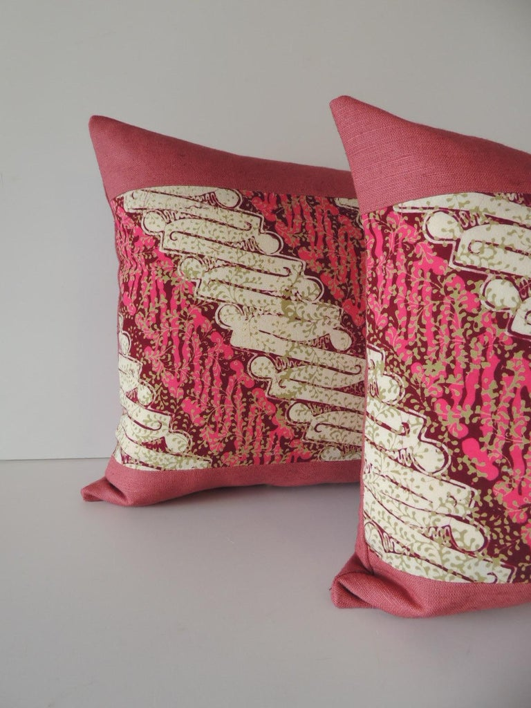 Pair of vintage pink and red batik lumbar decorative pillows. Decorative pillow handcrafted and designed in the USA. Closure by stitch (no zipper closure) with custom made feather/down pillow insert. Framed with same pink linen as