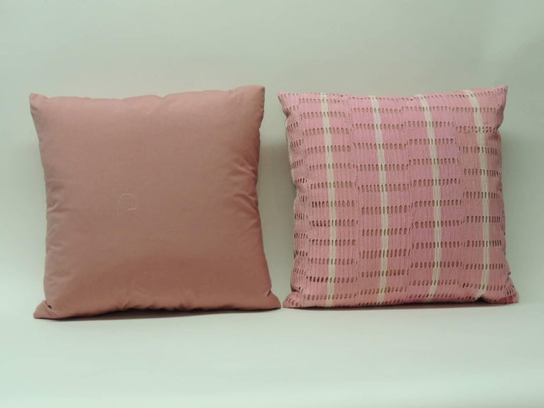 Pair of pink vintage Yoruba African woven textile pillows. Eyelet design creates a stripe pattern. Handcrafted and designed in the USA. handstitched (no zipper.) Custom made pillow inserts. Pink cotton underlining and backing. Boho-chic style