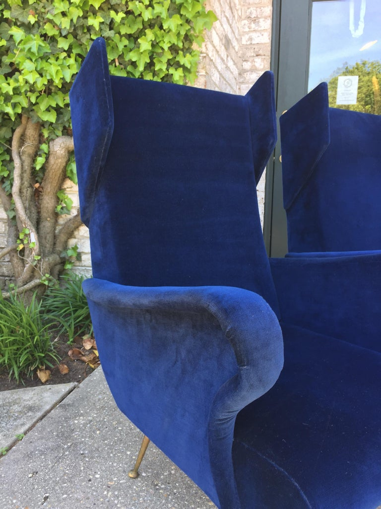 Mid-20th Century Pair of Vintage Ponti inspired Wingback Chairs For Sale