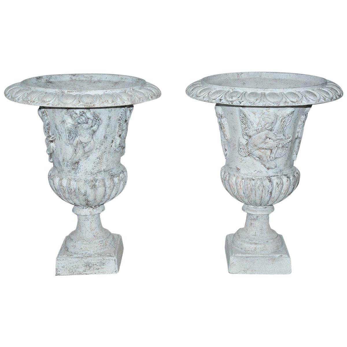 Pair of Vintage Putti Decorated Garden Urns