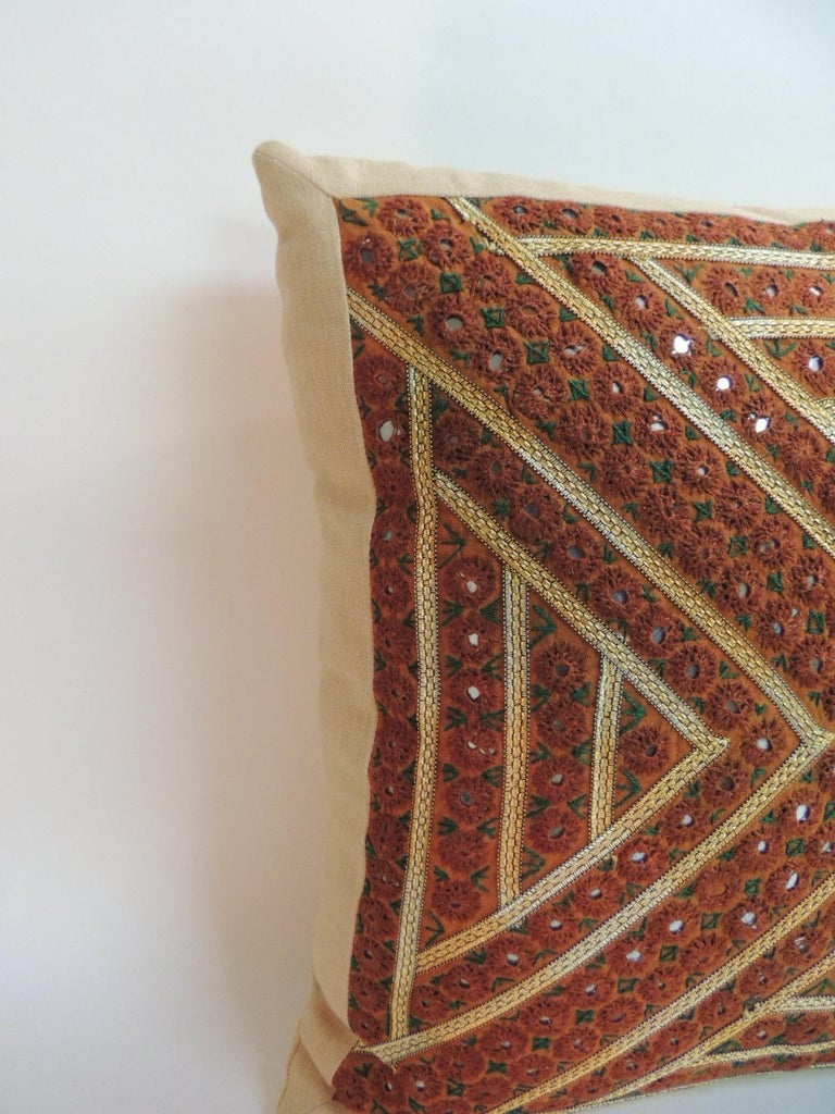 Pair of vintage rust and Green Embroidered Indian square pillows. Floral embroidery with gold threads trims and small sequences embellishments. Soft yellow linen frames and backings. Decorative pillow handcrafted and designed in the USA. Closure