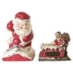 Pair of Vintage Santa Claus Still Banks, American, circa 1925 and 1960