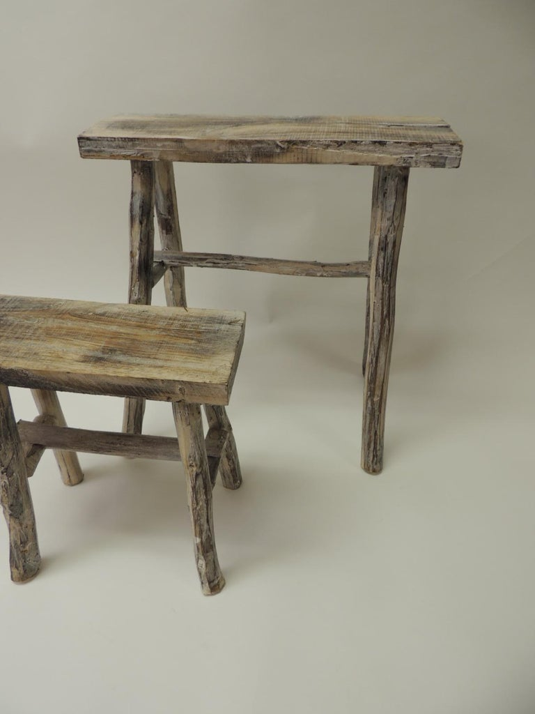 Rustic pair of vintage Asian white washed rubbed wood painted nesting artisanal side tables/stands. Nice and sturdy side tables, stands, great for bathroom decor, candles, planters. Measures: Tall: 15.5 x 10 x 17 H Short: 11 x 6.5 x 11 H.