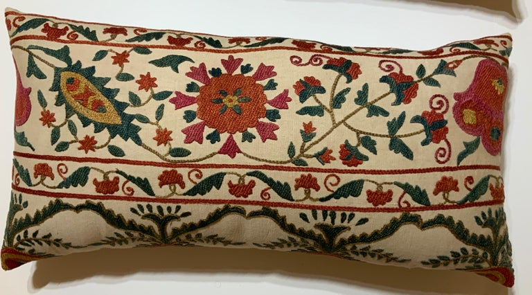 """Beautiful pair of pillows made of hand embroidery silk ,of colorful flowers and vines on a cream color cotton background. Fine linen backing, Frash insert. Sizes: 22"""" x 11"""" 22"""" x12""""."""