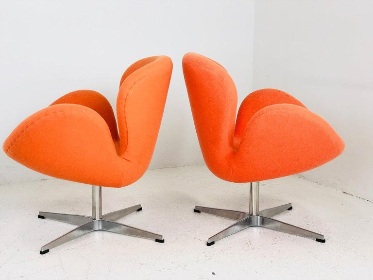 Pair of vintage Swan chairs in the style of Arne Jacobsen. Chairs are in good vintage condition and recommend new upholstery.  Dimensions: 28