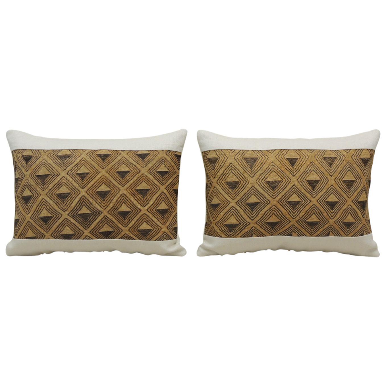 Pair of Vintage Tan and Brown African Kuba Decorative Bolster Pillows