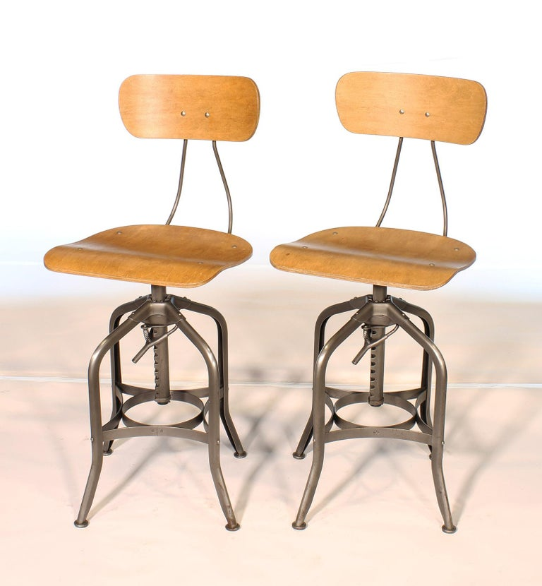 Industrial Pair of Vintage Toledo Bent Plywood Adjustable Stools For Sale