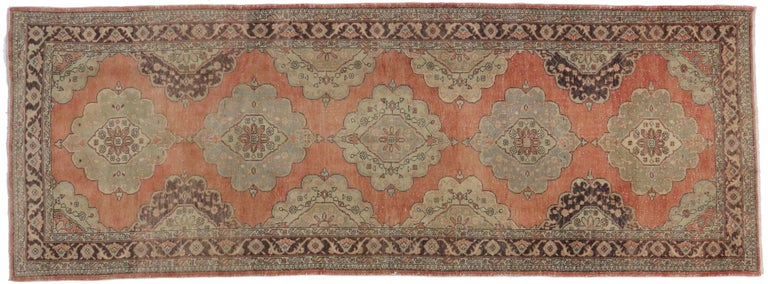 51142-51149 Pair of Vintage Turkish Oushak Gallery Rugs, Matching Hallway Runners. This pair of matching vintage Turkish Oushak gallery rugs each feature five lobed floral medallions spread across abrashed terracotta field. Spandrels and