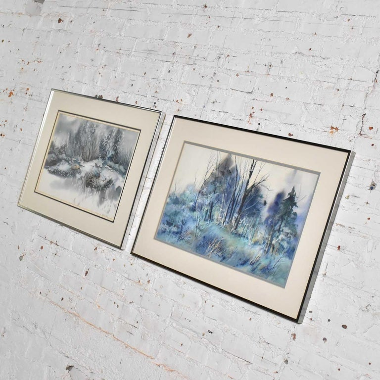 Handsome pair of watercolor paintings each depicting a different winter landscape by Dorothy M. Reece Kordash. They are in wonderful vintage condition and in their original frames. Please see photos, circa 1970s-1980s.  Wow! We are proud to be