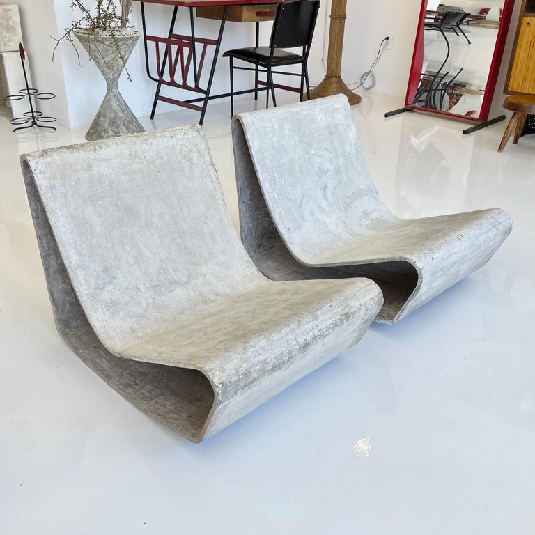 Fantastic set of vintage concrete loop chairs by Swiss designer Willy Guhl for Eternit. One of the most iconic chairs ever designed. No cracks. Great condition and patina.  Priced as a pair.   4 pairs available.