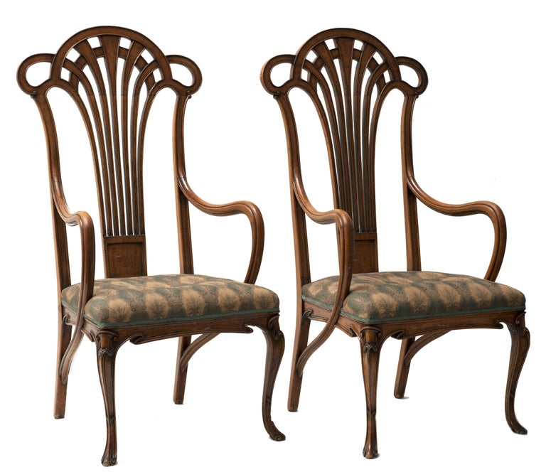 Beautiful pair of liberty armchairs in hickory, curved arms and front legs, seat dressed in cloth and seatback fan shaped. France, Art Nouveau period. Very good overall conditions, only minor flaws.  This object is shipped from Italy. Under