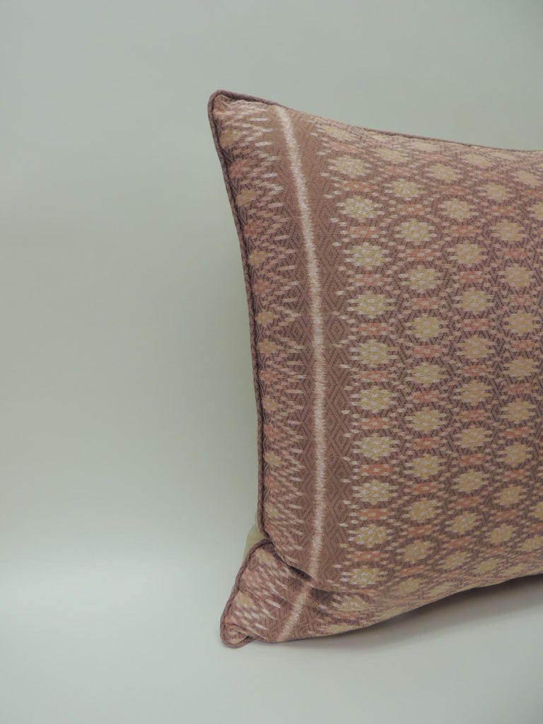 Pair of vintage woven pink silk Ikat decorative square pillows Pair of vintage woven pink silk decorative square pillows handcrafted with an Ikat textile from the Asian fiber arts tradition. The front panel of the decorative pillows depict a woven
