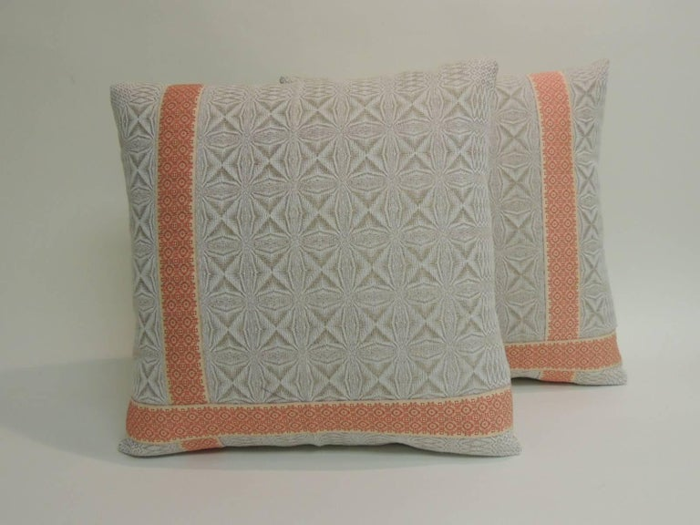 Pair of vintage woven Swedish decorative pillows with ribbon accents and natural linen backings.