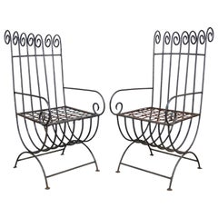 Pair of Vintage Wrought Iron Curule Whimsical Regency Style Scrolling Armchairs