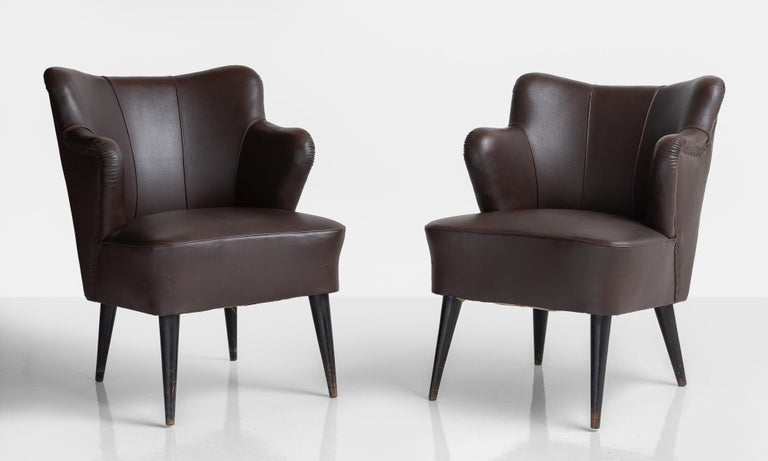 Pair of vinyl armchairs by G. Pulitzer Finali, Italy, circa 1940.  Unique modern forms with shortened armrests in original vinyl upholstery and wooden legs.