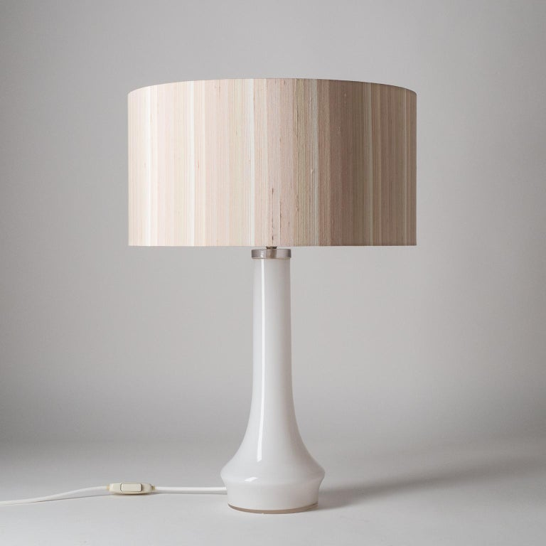 Rare pair of vistosi table lamps from the 1960s. Tapered opaline glass base with large silk shades. One original E27 socket with new wiring.