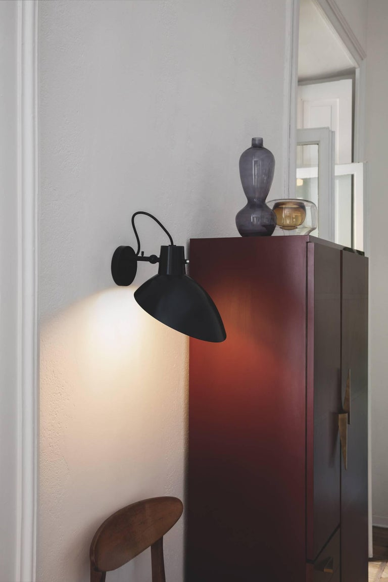 Pair of Vittoriano Viganò 'VV Cinquanta' sconces in black for Astep. Viganò was the art director of Arteluce, the company founded by his creative partner Gino Sarfatti, and the visor was one of his most celebrated designs. This is an authorized