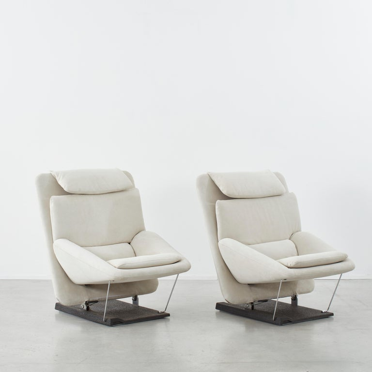 This stunning pair of lounge chairs will probably be the most comfortable thing you have ever sat in. The chair's rectangular body looks minimal and clean from the back whilst there is a slight hint of a futurist aesthetic from the front. The seat