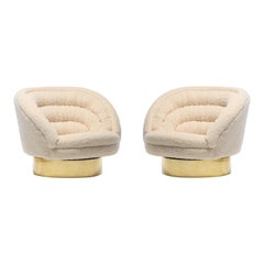 Pair of Vladimir Kagan Crescent Swivel Chairs in Ivory Bouclé with Brass Bases